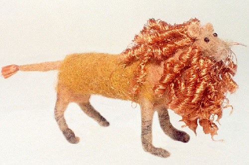 Lion. Miniature handmade felted toy of wool by Russian artist Marina Nikitina