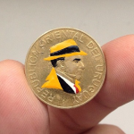 Controversial coin art by Andre Levy