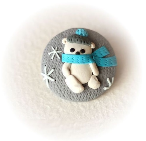 Nice bear. Brooch. Made of polymer clay in the author's technique of patchwork modeling
