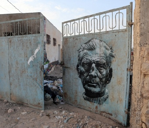 Painting on a gate in Erriadh village, Tunisia. Street artists Know Hope (USA) and Orticanoodles (Italy)