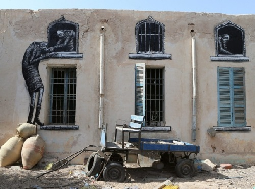 Painting on the wall of Erriadh village, Tunisia. British Street artist Tinho