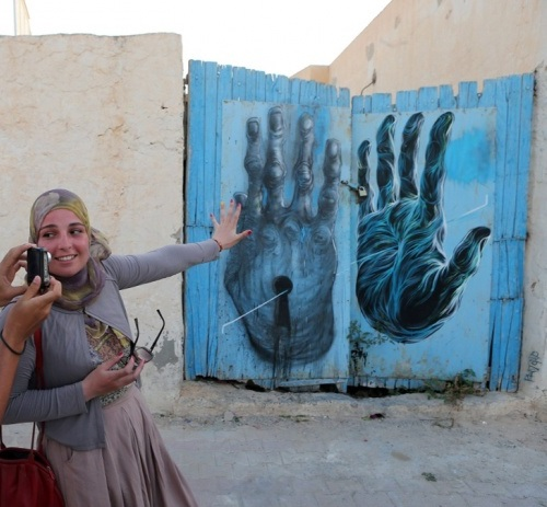 Painting on the wall of Erriadh village, Tunisia. Street artist Bom.K., France