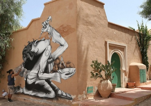 Painting on the wall of Erriadh village, Tunisia. Street artist Claudio Ethos, Brazil