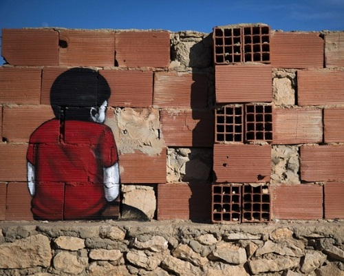 Painting on the wall of Erriadh village, Tunisia. Street artist Tinho, Brazil
