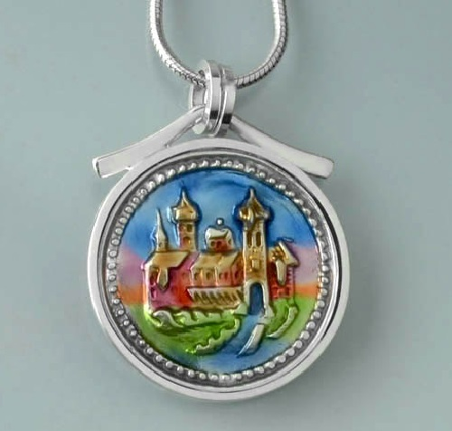 Pendant featuring a landscape- town image from an antique button
