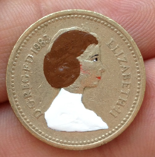 Princess Leia on an image of Queen Elizabeth II. Miniature painting on coins. Art by Andre Levy