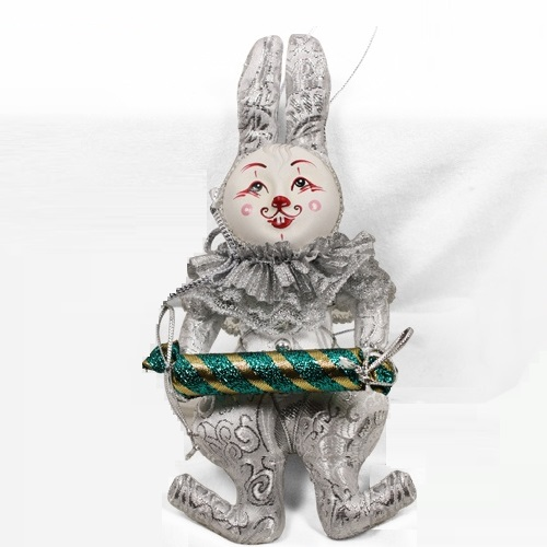 Rabbit with a sweet. Christmas handmade decoration with the elements of the porcelain