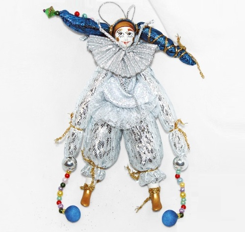Silver clown. Christmas handmade decoration with the elements of the porcelain