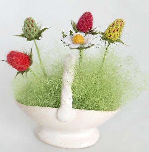 A basket of Strawberry. Miniature handmade felted toy of wool by Russian artist Marina Nikitina