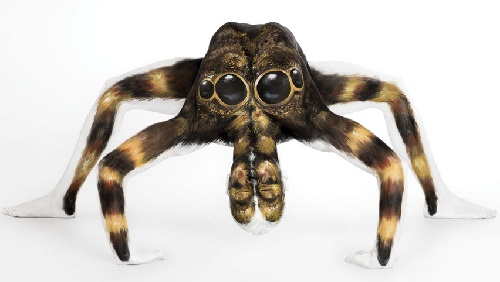 The human spider, painted on ultra-flexible model - contortionist. Body painting by British artist Emma Fay