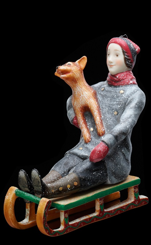 Collectible porcelain miniature 'Boy on a sled'