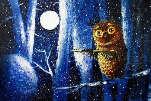 Owl in winter forest