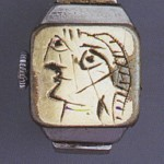 engraved on brass plate of Juvénia watch inserted in chromium-plated metal ring, c. 1936-1939