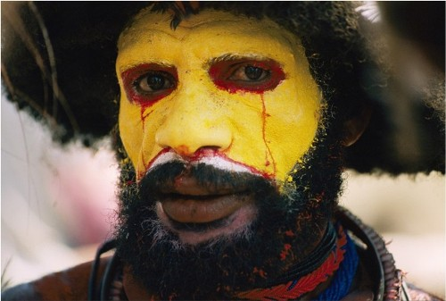 Yellow color. Ritual coloring of native of Papua New Guinea for a ceremonial dance greeting Sing Sing