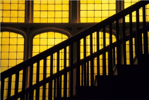 Yellow color. Staircase in front of the stained glass wall of University of Colorado