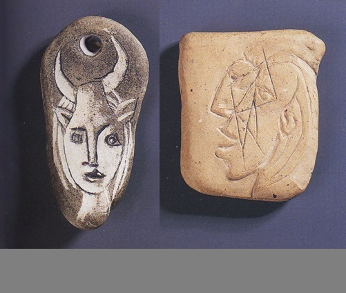 Tête de Faune pendant amulet of engraved soft stone and Femme Qui Pleure engraved terra cotta amulet made by Pablo Picasso for Dora Maar, c. 1937
