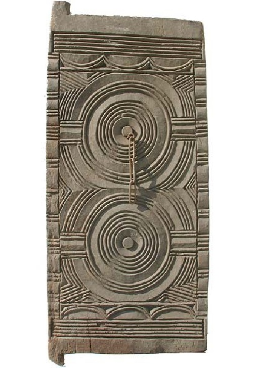 the door can be cut from a sacred tree. Nigeria, the sacred tree of Iroko