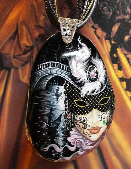 Author's painting on the agate. Mask flickers and shimmers with multicolored sparkles