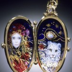Medallion with two beautiful images inside it. Jewelry Art by California based duo of artists Mona & Alex Szabados