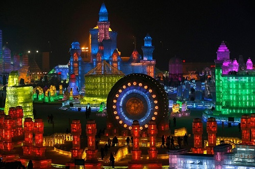 At night, the ice city illuminated by LED lamps and lasers, looks especially beautiful. Harbin International Festival of ice sculpture