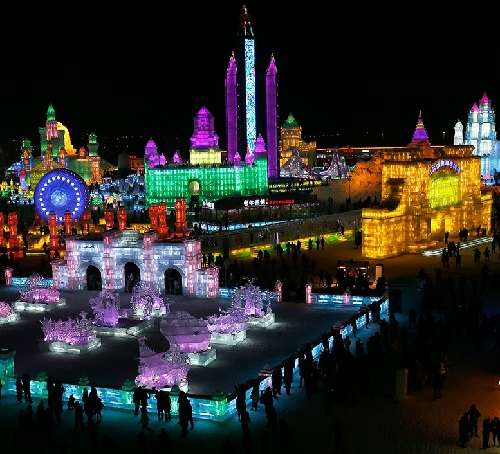 People admire the colorful ice sculptures in Harbin