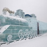 Visitors look at the ice sculpture of a train in Harbin