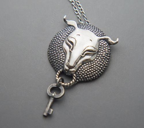 Silver pendant in the form of a sheep's head, which holds the key. Key movable hanging, polished and aged. Silver art by Anna Kiryanova and Ivan Chernykh