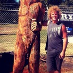 Bigfoot drinking a beer hiding from the sun. Ryan Cook chainsaw sculpting