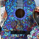 Decorated with CD mosaic guitar
