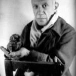 Photo of Pablo Picasso with an owl