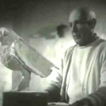 Photo of Pablo Picasso in his workshop, sculpting an Owl