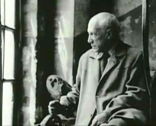 Black and white photo of Pablo Picasso with an owl