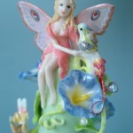 Composition of a fairy with a bird. Porcelain miniature