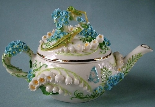 Decorated with Porcelain flowers tea pot. Handmade art by Svetlana Oreshkina