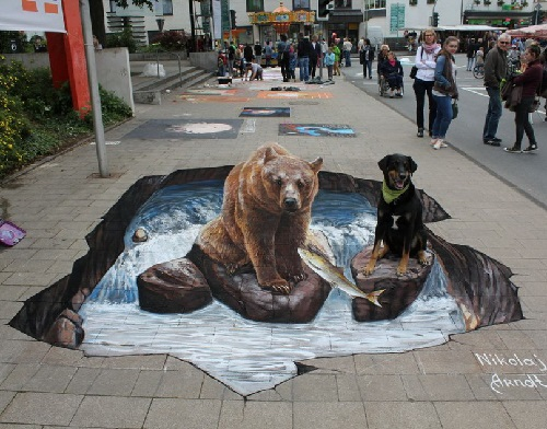 The Bear and the Rottweiler. Realistic 3D street painting by Nikolaj Arndt