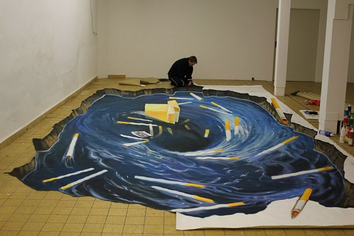 Three-dimensional picture painted on the floor in the room - contribution to the fight against smoking