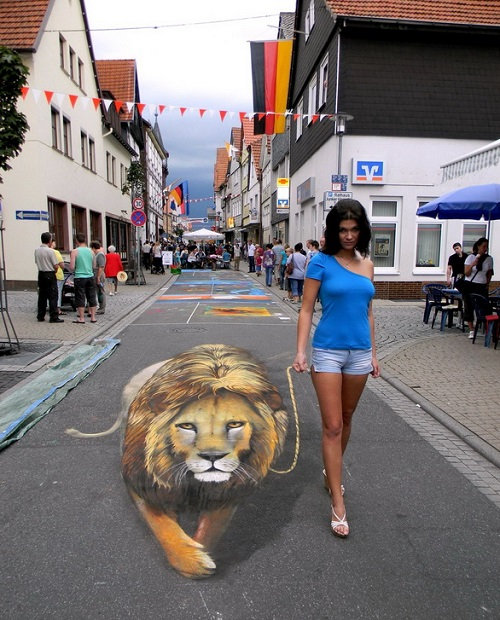 Walking with a 3D painted lion. Realistic 3D street painting by Nikolaj Arndt