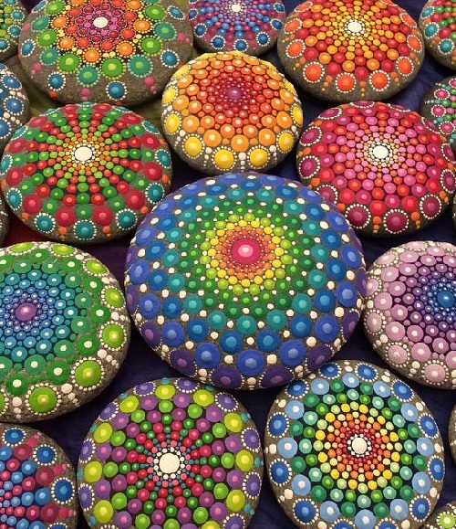 Elspeth McLean painting mandala stones. All the mandala stones Elspeth McLean created while visiting her home town in Perth, Western Australia