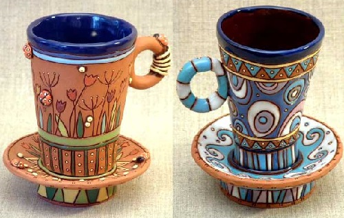 Beautiful hand made cup, carved and painted with glaze and under-glaze
