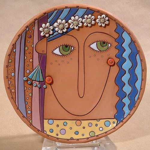 Beautiful hand made plate, carved and painted with glaze and under-glaze