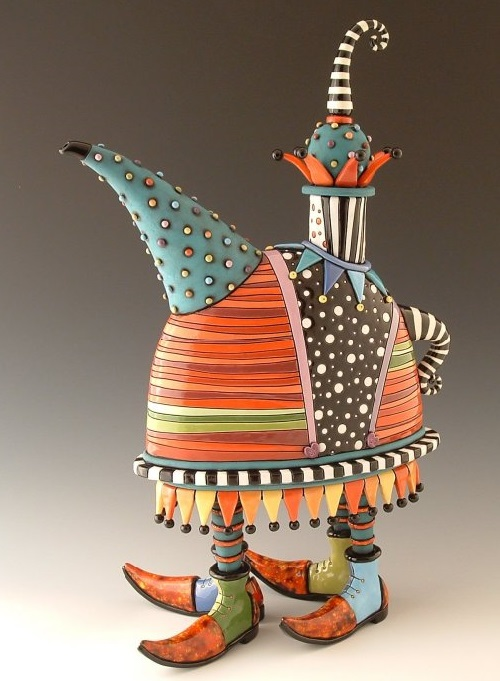 Beautiful hand made teapot, carved and painted with glaze and under-glaze. Artwork by ceramic artist Natalya Sots