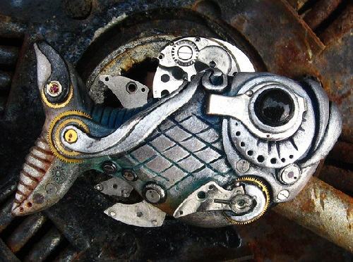 Bio-mechanical fish - pendant. Material - polymer clay, pastels, metallic powders, parts of watch movements, lacquer. Maria Jia steampunk jewelry