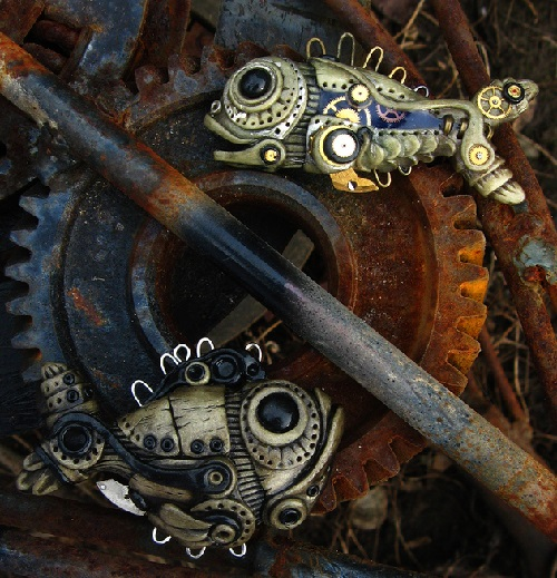 Bio-mechanical fish. Material - polymer clay, pastels, metallic powders, parts of watch movements, lacquer. Maria Jia steampunk jewelry