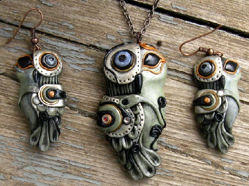 Bio-mechanical owl. Material - polymer clay, pastels, metallic powders, parts of watch mechanisms, varnish. Maria Jia steampunk jewelry