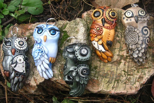 Bio-mechanical owls. Material - polymer clay, pastels, metallic powders, parts of watch mechanisms, varnish. Maria Jia steampunk jewelry