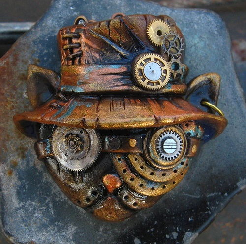 Cat Hatter. Material - polymer clay, pastels, metallic powders, parts of watch mechanisms, lacquer