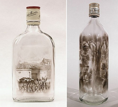 Pictures painted with smoke inside empty glass bottle. Art by American artist Jim Dingilian