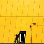 Black door in a yellow house. Colors of Istanbul. Photographer Yener Torun