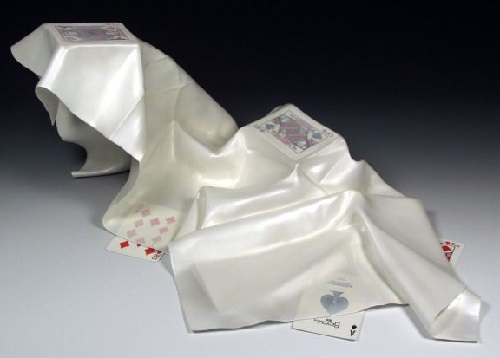 Hyperrealistic wooden sculpture of silky fabric and cards by professor Tom Eckert
