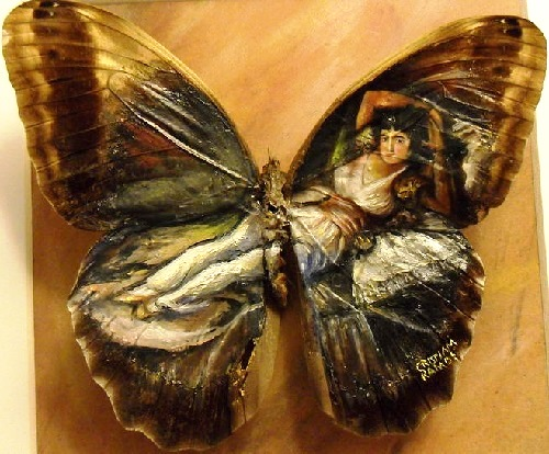 Awesome miniature Painting on real butterfly wings. Artist Cristiam Ramos